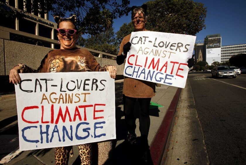 Pearl and Norm Anderson, from Pasadena, joined hundreds of climate change protesters along Wilshire Boulevard in Los Angeles on Saturday.