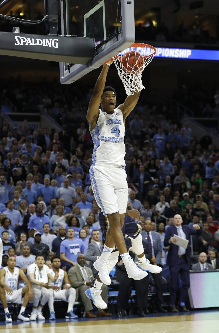 North Carolina's Isaiah Hicks dunks the ball during the second half of a regional final men's college basketball game against Notre Dame in the NCAA Tournament, Sunday, March 27, 2016, in Philadelphia. (AP Photo/Chris Szagola)