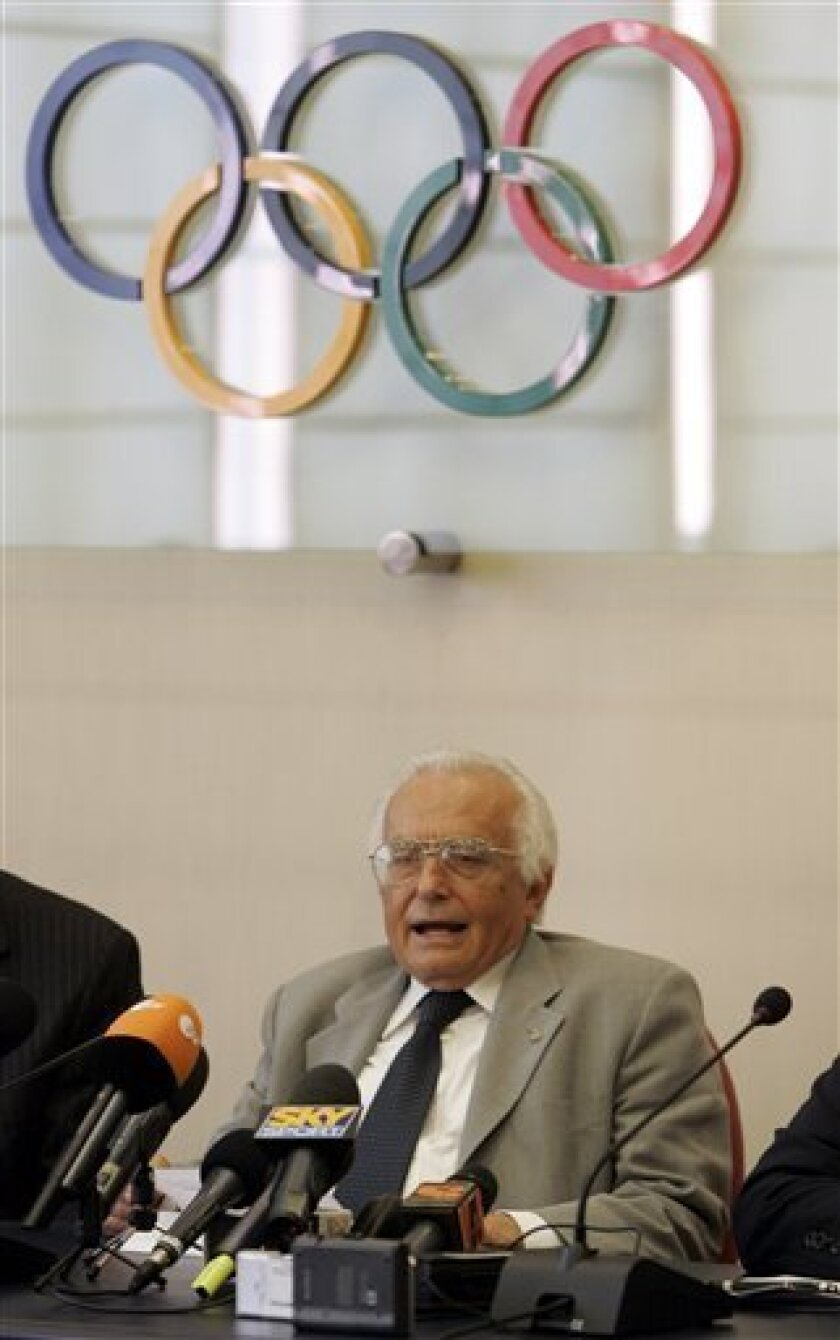 """FILE - In this May 15, 2007 file photo, CONI Olympic committee prosecutor Ettore Torri answers journalist questions during a press conference at the CONI headquarters in Rome. After four years as the Italian Olympic Committee's anti-doping prosecutor, Torri is convinced that all pro cyclists are doping. In his first interview in two years, he told The Associated Press it's not just a personal hunch anymore: """"I'm not the only one saying it. Lately, all of the cyclists I've interrogated have said that everyone dopes."""" (AP Photo/Pier Paolo Cito, File)"""