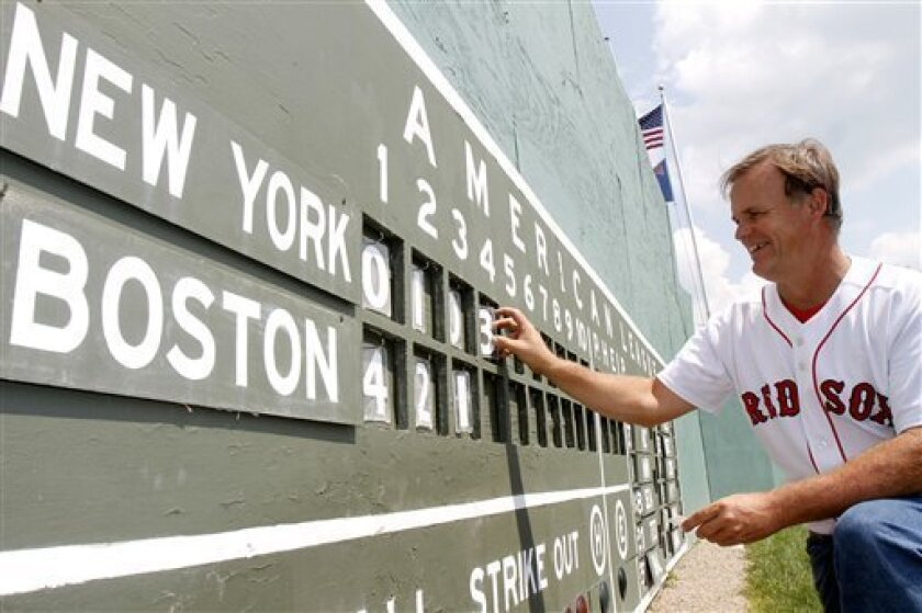 Pat O'Connor changes the scoreboard at Little Fenway, a scaled-down version of the major league field in Essex, Vt., Monday, Aug. 2, 2010. Little Fenway is a unique 1/4th scale replica of Boston's Fenway Park in the backyard of Pat & Beth O'Connor's house in Essex, Vermont. It was built in 2001 and