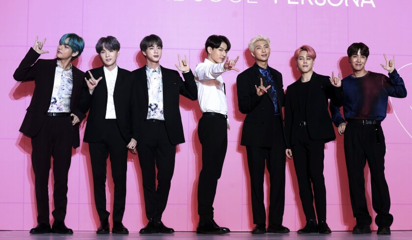 FILE - Members of South Korean K-Pop group BTS appear during a press conference in Seoul, South Korea.
