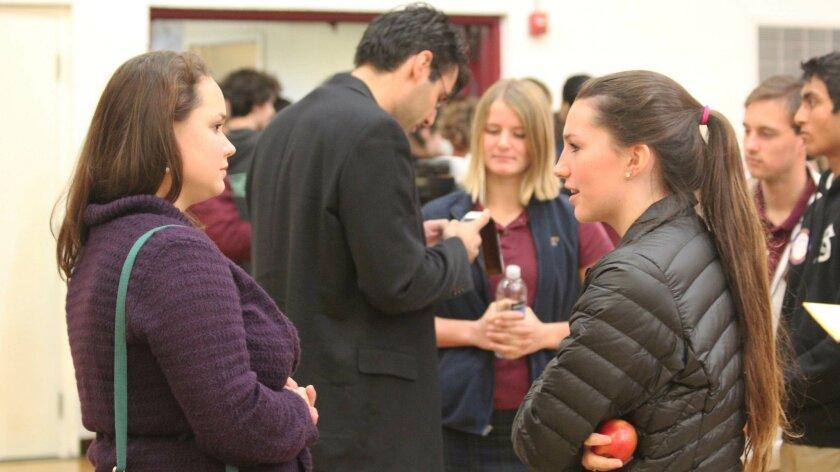 Mester speaks with Bishop's School senior Ashlyn Hegener following her presentation.