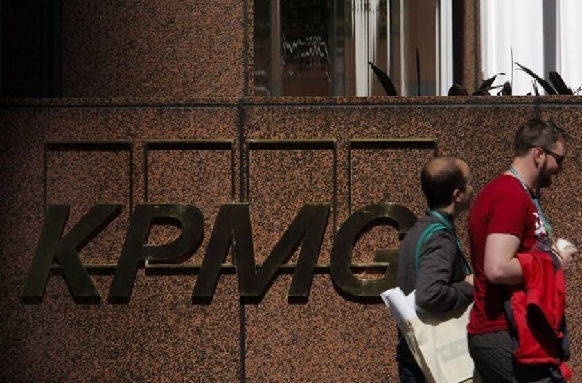 KPMG auditor was photographed accepting cash bribe over coffee