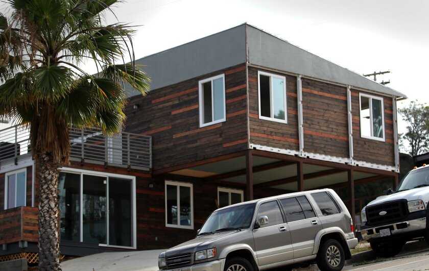 The container house is located on a steep part of Island Avenue, at the corner of 26th Street.