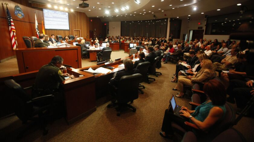 SANTA ANA, CA., MAY 13, 2014: The Orange County Board of Supervisors votes in favor of implementing