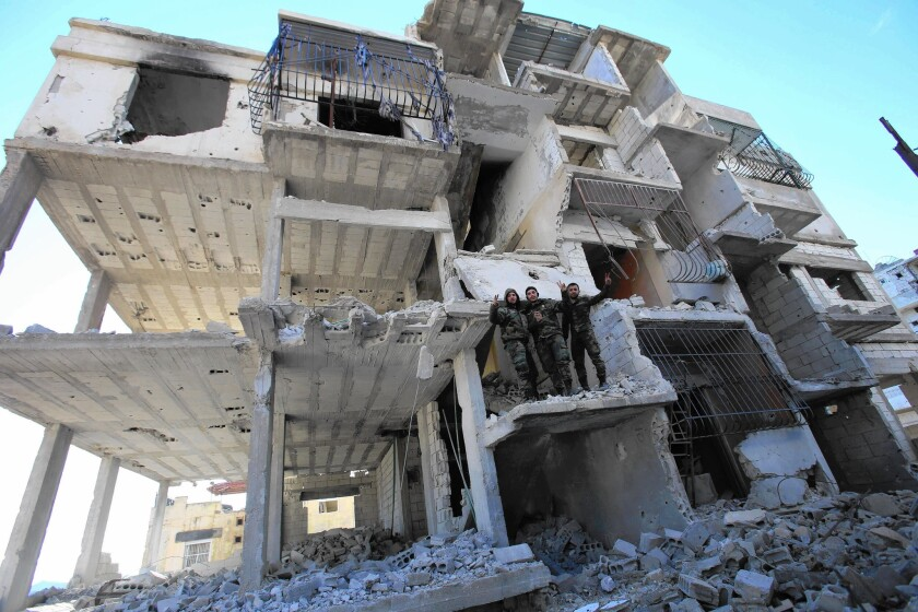 Pro-government fighters in the strategic Syrian town of Salma in Latakia province on Jan. 15.