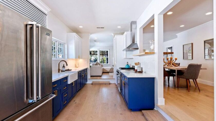 Blue cabinets add a pop of color to the bungalow that Tucker Halpern and Sophie Hawley-Weld recently sold.