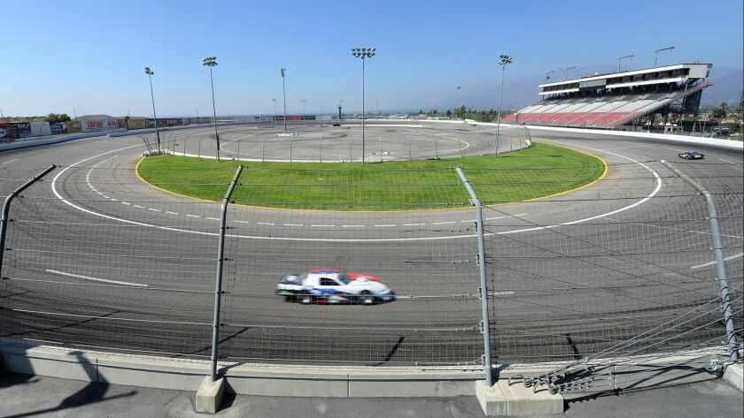 FILE - In this Oct. 2, 2013 file photo, a car speeds around Irwindale Speedway in Irwindale, Calif.
