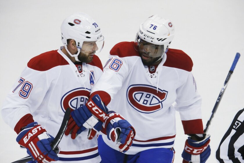 Montreal Canadiens defenseman Andrei Markov, left, of Russia, celebrates scoring a goal with defenseman P.K. Subban against the Colorado Avalanche in the first period go an NHL hockey game Wednesday, Feb. 17, 2016, in Denver. (AP Photo/David Zalubowski)