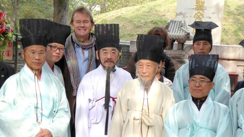 "Michael Wood with Korean scholars at the Confucian cemetery in Qufu. Wood hosts ""The Story of China"