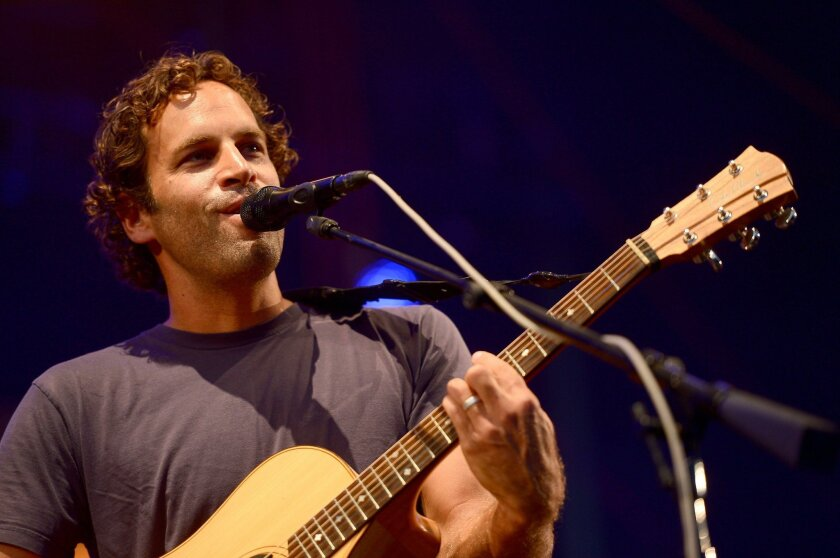 Jack Johnson performs onstage during Day 4 of the Firefly Music Festival on June 22, 2014 in Dover, Delaware. Michael Loccisano \ Getty