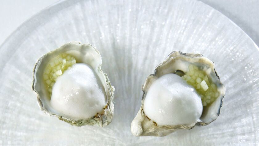 Kumomoto Oyster with sorrel and horseradish mousseline by chef William Bradley at Addison at the Grand Del Mar.
