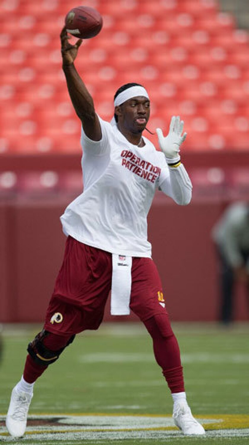 Robert Griffin III was fined $10,000 for wearing this T-shirt.