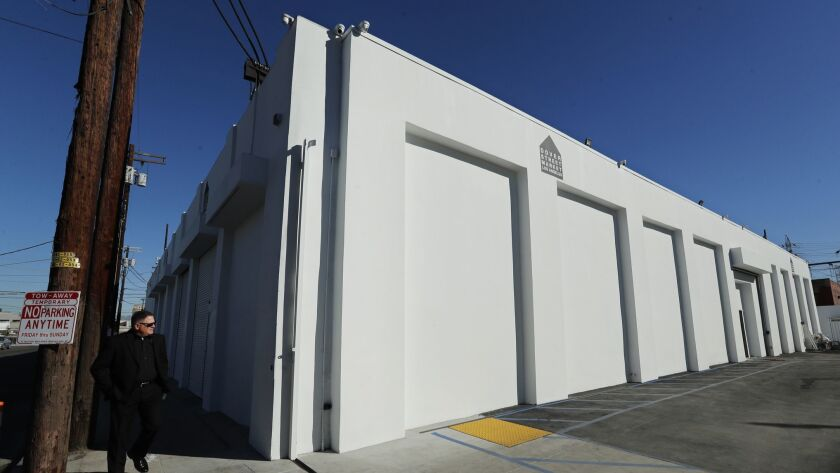 An exterior view of the windowless Los Angeles Dover Street Market on the corner of Imperial and Sixth streets in the DTLA Arts District.
