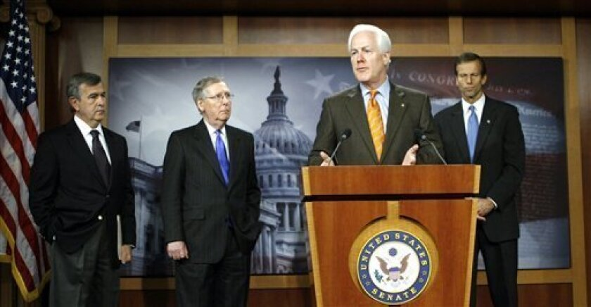 Sen. John Cornyn, R-Texas, speaks during a news conference on Capitol Hill in Washington, Saturday, Dec. 5, 2009. From left, Sen. Mike Johanns R-Neb., Senate Minority Leader Mitch McConnell, R-Ky., and Sen. John Thune, R-S.D., listen. (AP Photo/Jose Luis Magana)