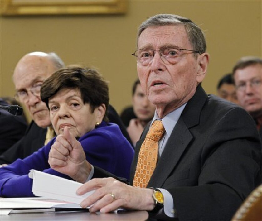 FILE - In a Tuesday, Nov. 1, 2011 file photo, former Senate Budget Committee Chairman Pete Domenici, R-N.M., right, speaks before the Joint Select Committee on Deficit Reduction during a hearing on Capitol Hill in Washington. Former U.S. Sen. Domenici is acknowledging he fathered a son outside his