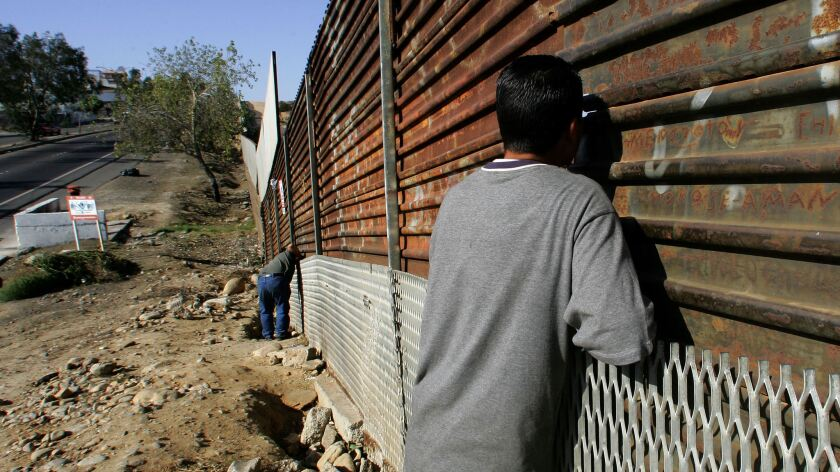 Mexican citizens wait to cross the borde