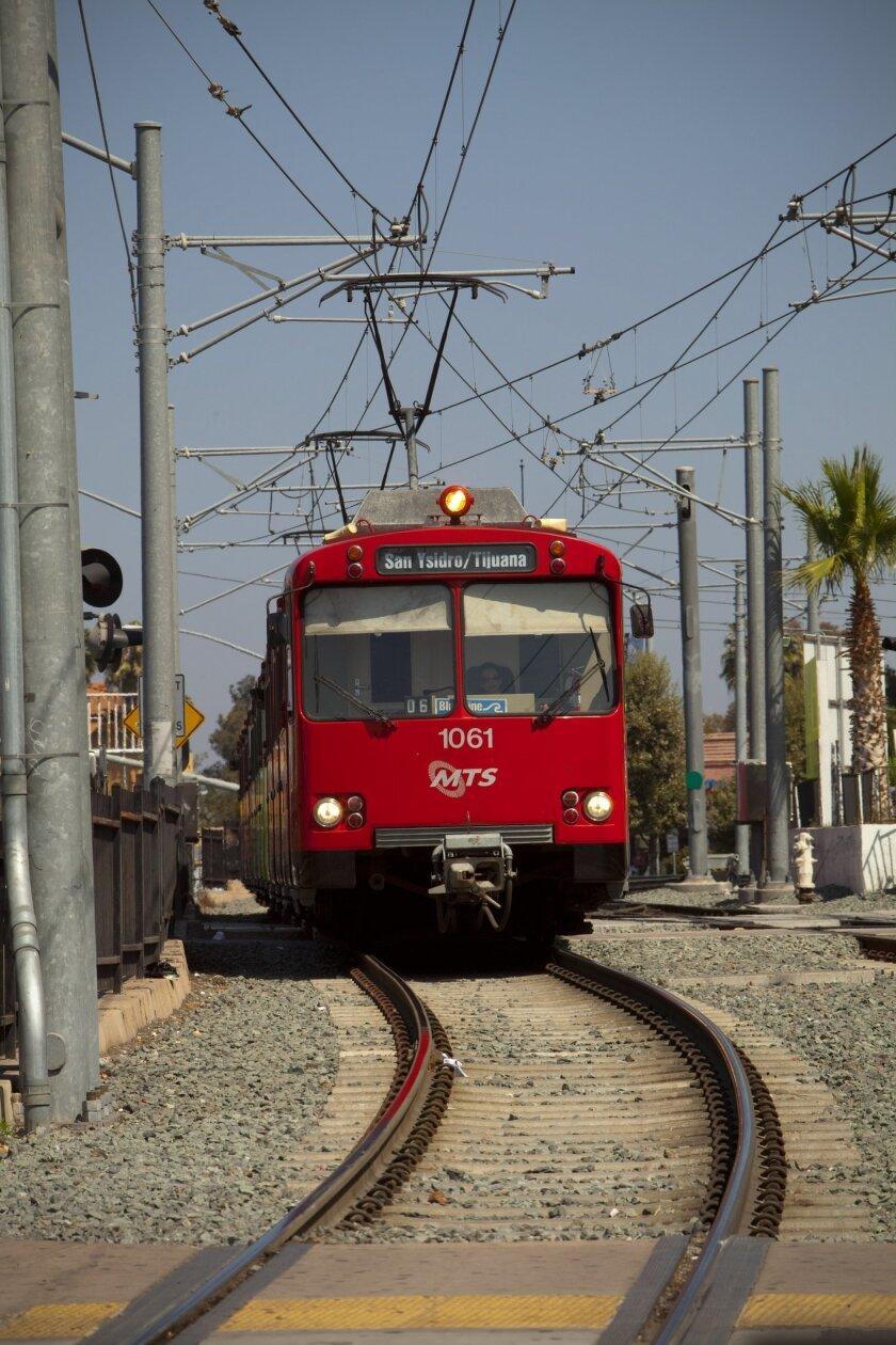 A San Diego trolley car moves along a track.