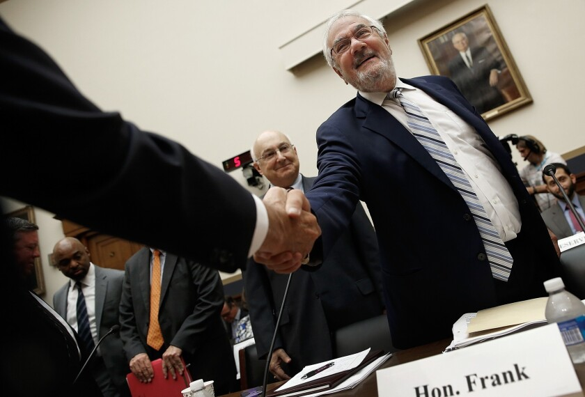 Barney Frank, whose name is on the Dodd-Frank Act, greets former colleagues before testifying.