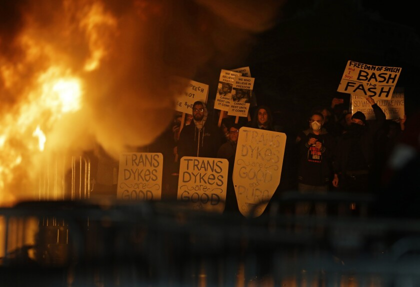 Protesters watch a fire at Berkeley's Sproul Plaza during a rally in February against a scheduled ap