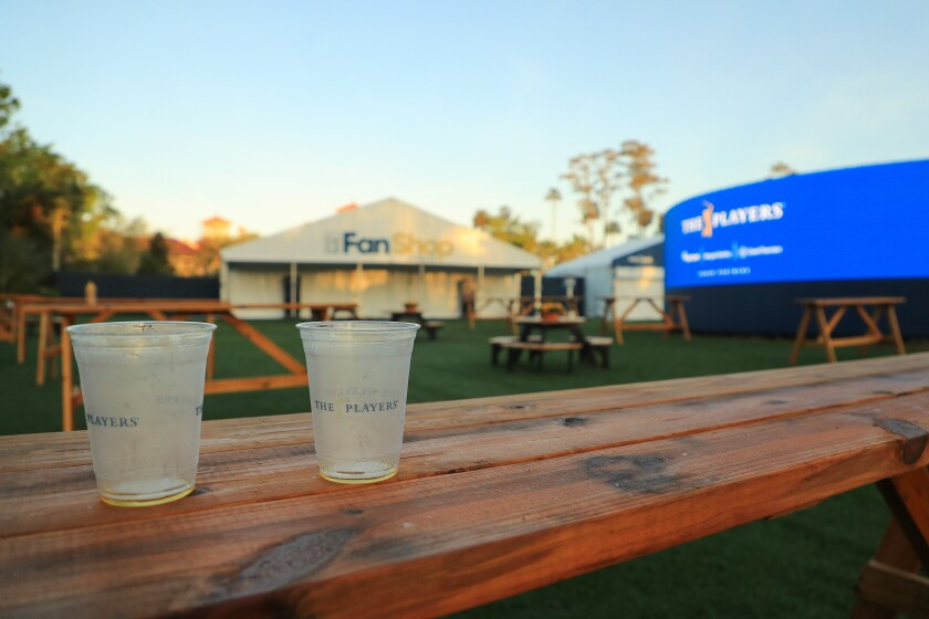 Two empty cups are seen on a table in an empty fan area after the cancellation of the The PLAYERS Championship at TPC Sawgrass on March 13.