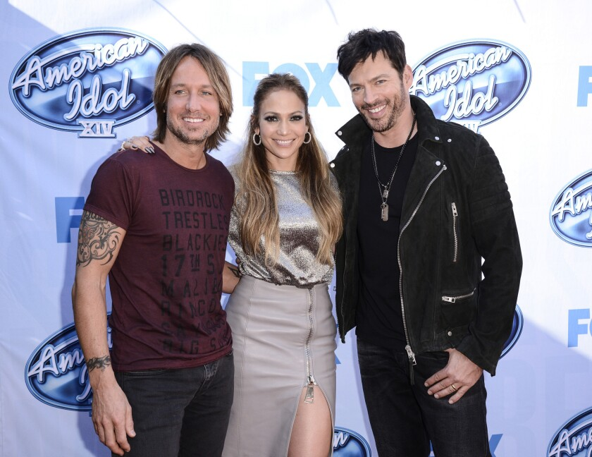 """Judges Keith Urban, Jennifer Lopez and Harry Connick Jr. arrive on set of """"American Idol"""" in Los Angeles on Dec. 9, 2014."""