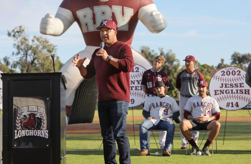 Dodgers manager Dave Roberts speaks at Saturday's ceremony at Rancho Buena Vista High School where his jersey was retired, along with that of other former Longhorns players Tony Wolters (9) Jesse English (14).