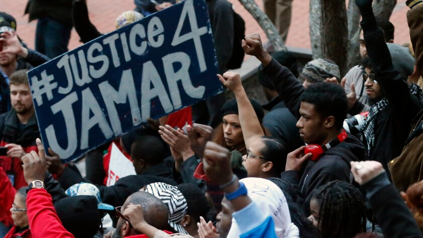 Demonstrators protest the fatal Minneapolis police shooting of Jamar Clark in 2015.