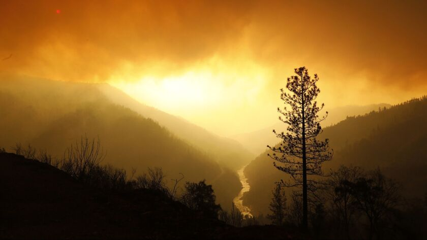Smoke fills the sky as the Camp fire continues to burn along the North Fork of the Feather River.