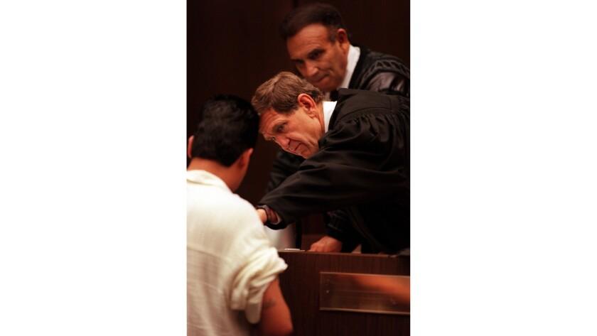 ME.Tattoo.JudgeCarter.0116.KCññJudge David Carter(middle) examines gang tattoos on an individual o