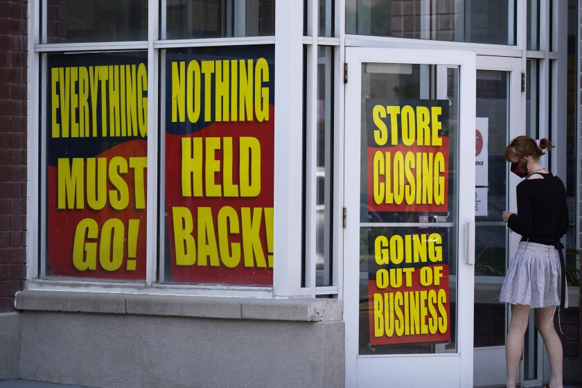 Store-closing signs on a Stein Mart in Salt Lake City