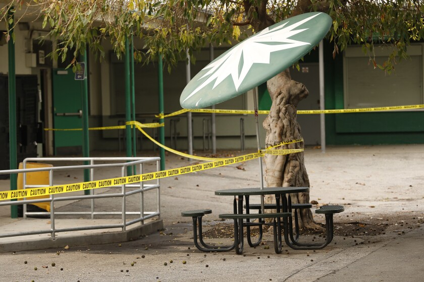 Common areas are marked with yellow caution tape at closed Dorsey High School