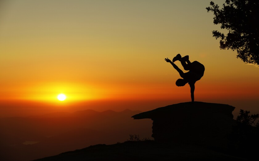 A hiker takes a leap at Potato Chip Rock in Mt. Woodson, northeast of San Diego.