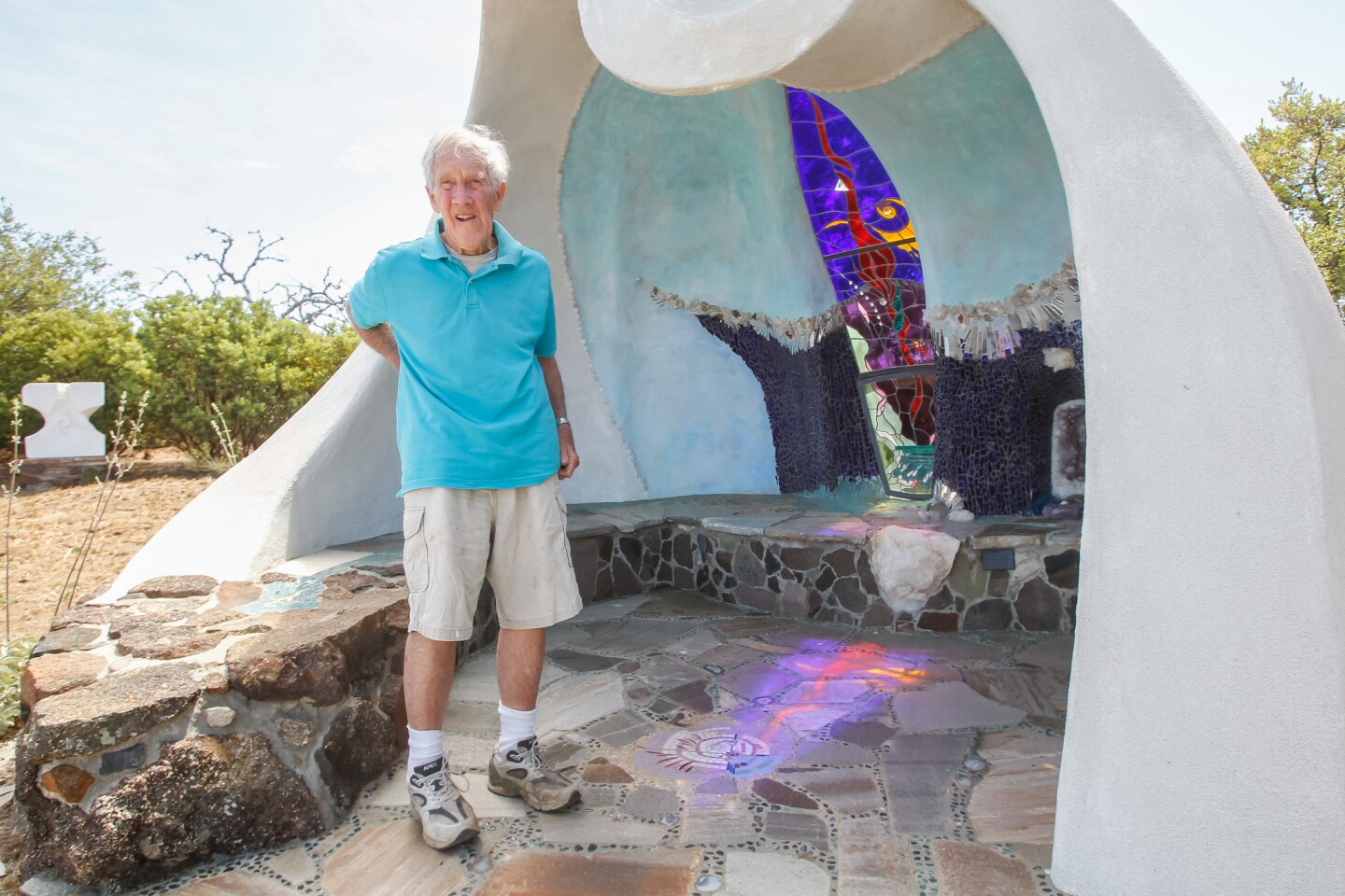 Artist James Hubbell in May 2018 stands at the chapel he built on his property in Santa Ysabel, California.