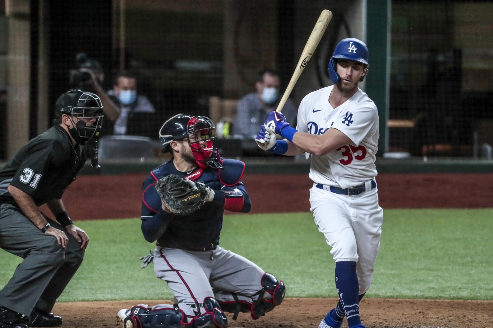 Dodgers center fielder Cody Bellinger strikes out during the fourth inning against the Atlanta Braves.