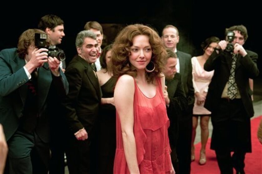 """This film publicity image released by RADIUS-TWC shows Amanda Seyfried as Linda Lovelace in """"Lovelace."""" (AP Photo/RADIUS-TWC, Dale Robinette)"""
