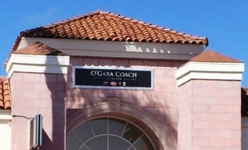 Time of changing signs: Symbolic Motor Car Co. in La Jolla is bears O'Gara Coach sign over its entrance.