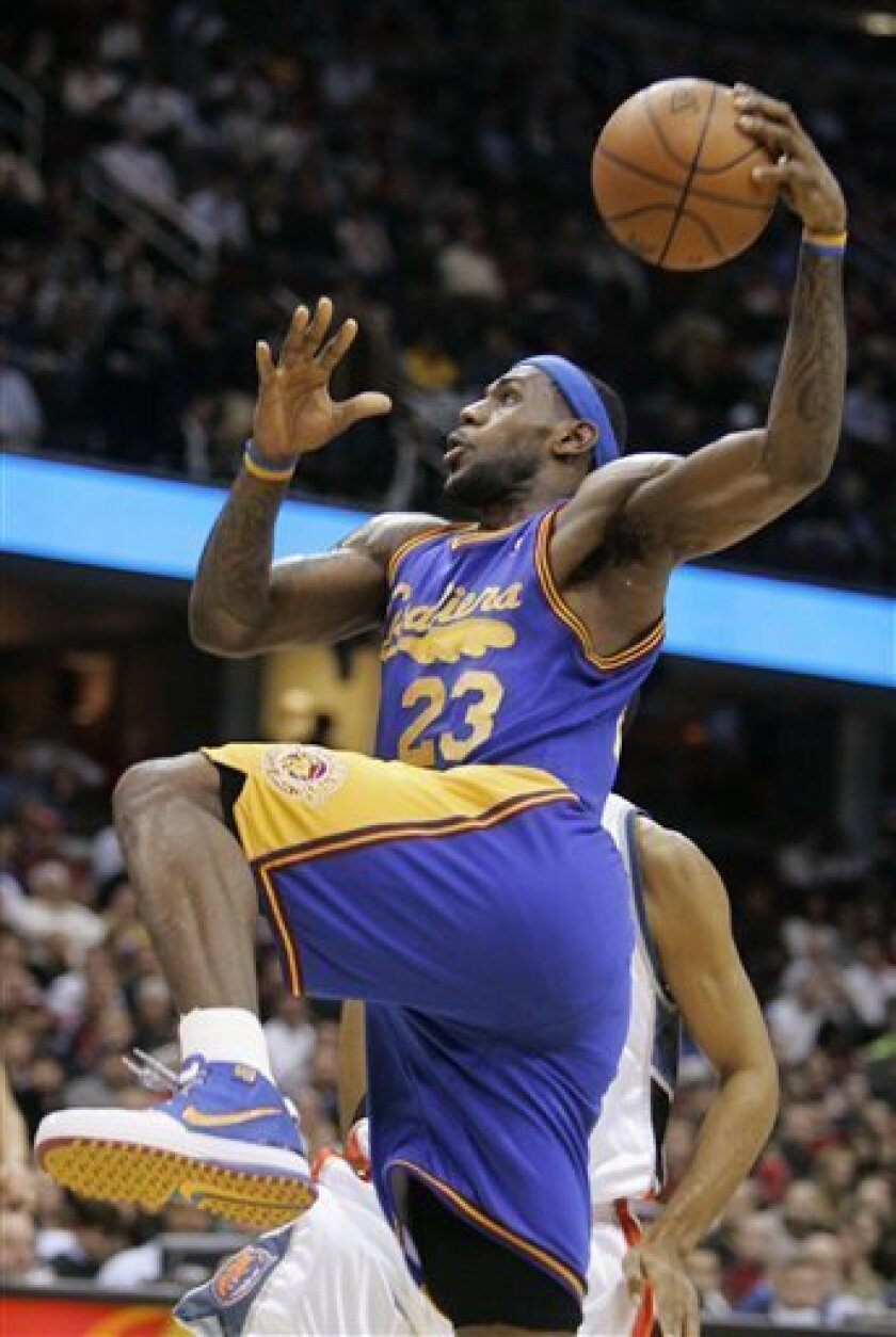 Cleveland Cavaliers' LeBron James goes up for a dunk against the Charlotte Bobcats in the first quarter of an NBA basketball game Wednesday, Jan. 7, 2009, in Cleveland. The Cavaliers won 111-81. (AP Photo/Mark Duncan)