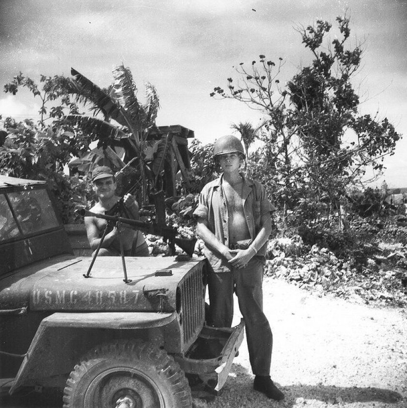 Marine Capt. Doug Inman (right) during the invasion of the Pacific island of Angaur in 1944 with a captured Japanese light machine gun