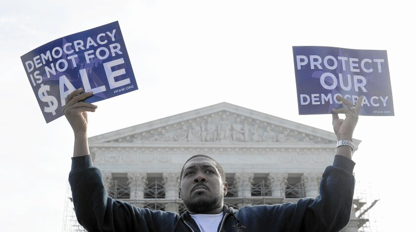 Cornell Woolridge of Windsor Mill, Md., takes part in a demonstration outside the Supreme Court in Washington as the court heard arguments on campaign finance in October.