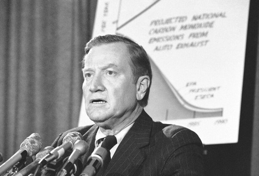 Russell Train, shown speaking at a news conference in 1975, led the Environmental Protection Agency from 1973 to 1977. In 1991, he was awarded the Presidential Medal of Freedom, the nation's highest civilian honor.