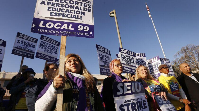 LOS ANGELES, CA – FEBRUARY 26, 2018: LAUSD campus aide Nancy Ramirez-Chavez, left, joins school wo