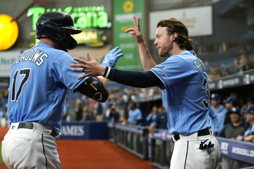 Tampa Bay Rays' Austin Meadows (17) celebrates his solo home run against the New York Yankees with Brett Phillips during the sixth inning of a baseball game Thursday, July 29, 2021, in St. Petersburg, Fla. (AP Photo/Chris O'Meara)