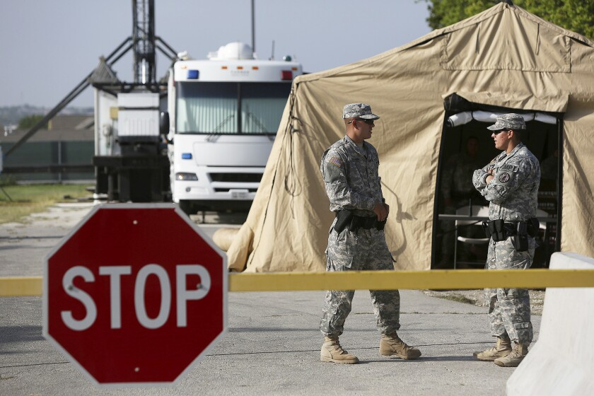 Soldiers guard a security checkpoint outside the Lawrence H. Williams Judicial Center at Ft. Hood, Texas, where Maj. Nidal Hasan is being tried for a 2009 shooting rampage at the base.