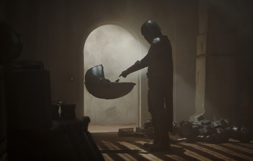 """This image released by Disney Plus shows a scene from """"The Mandalorian."""" An announcement on the Star Wars Twitter account Wednesday said new episodes would be available on Disney+ starting on Oct. 30. (Disney Plus via AP)"""