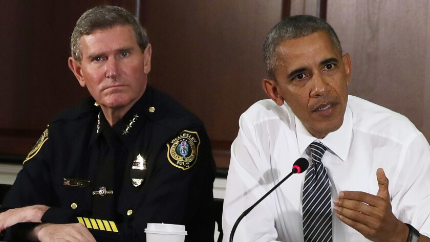 President Obama speaks alongside Terry Cunningham of the International Assn. of Chiefs of Police during a conversation on community policing on July 13, 2016, in Washington, D.C.