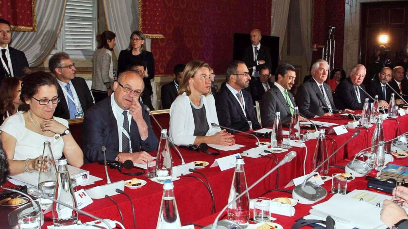 Foreign ministers from the Group of 7 nations and support staff confer during a meeting in Lucca, Italy, on Tuesday.
