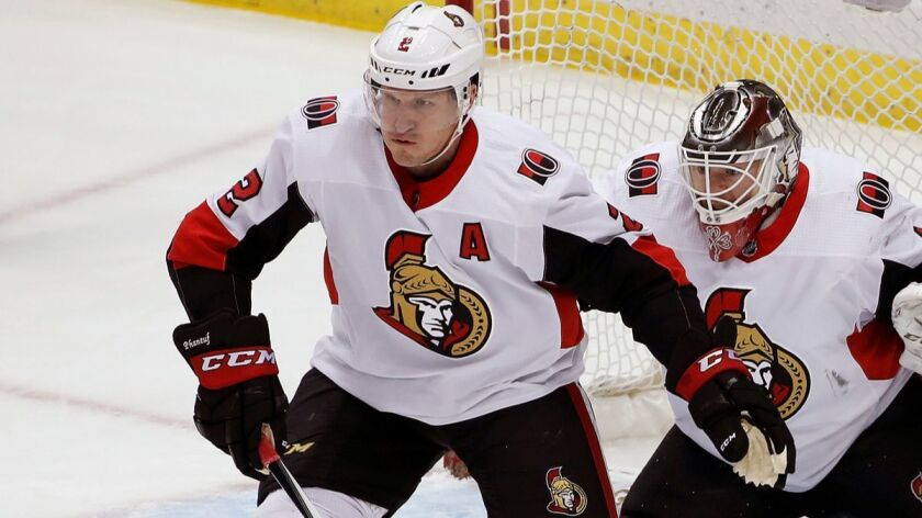 Dion Phaneuf, helping out goaltender Mike Condon while with the Ottawa Senators, fills a Kings need as a top-four defenseman with leadership and experience.
