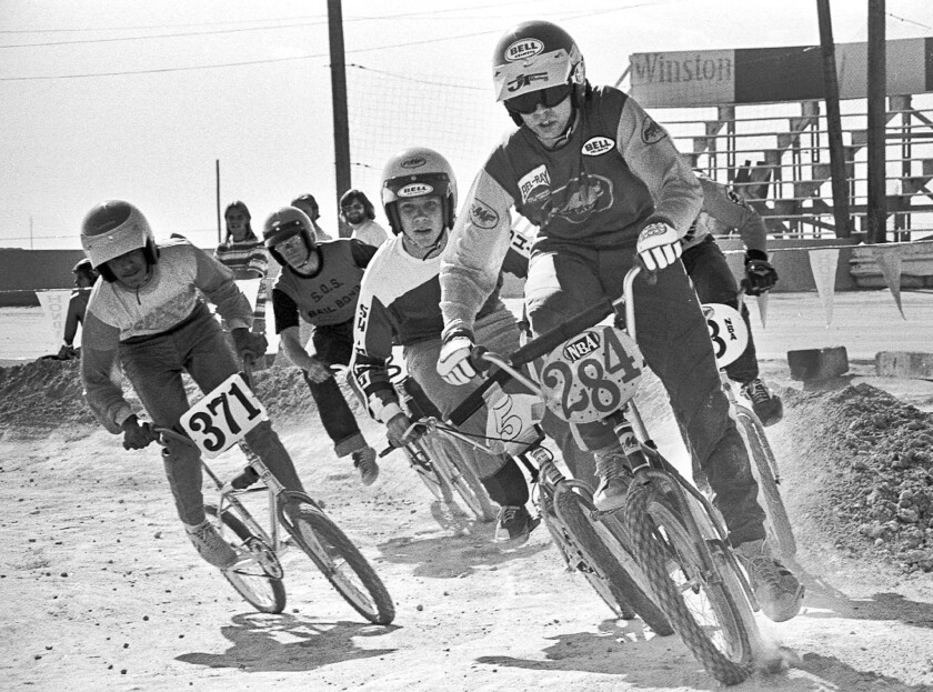 Scot Breithaupt leads the pack in a BMX bicycle race in Las Vegas in 1976. Breithaupt organized races on dirt motorcycle courses in the early 1970s and founded BMX. In 2008, the sport debuted in the Olympics in Beijing.