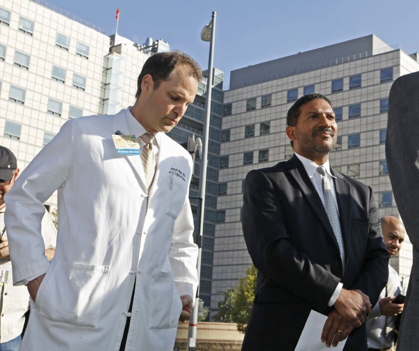 Dr. Zachary Rubin, medical director of clinical epidemiology at UCLA's Ronald Reagan Medical Center, left, and Dr. Robert Cherry, chief medical and quality officer for UCLA Health System, take questions last month about a superbug outbreak.